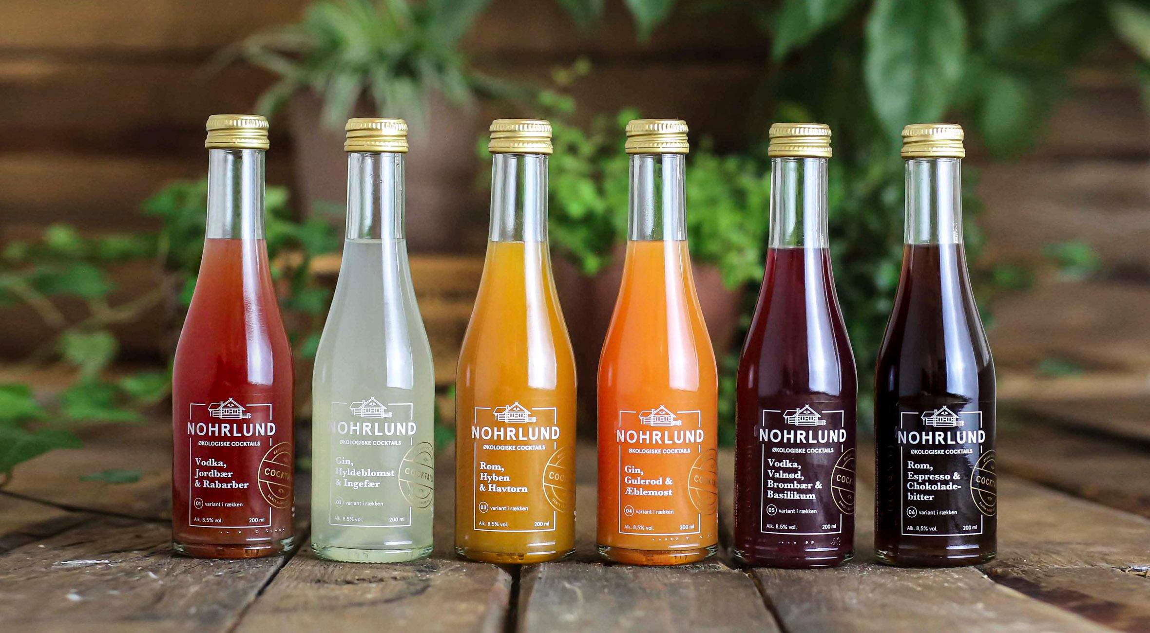 Få 6 pre-mixed cocktails fra Nohrlund på flaske – Nyd prisvindende cocktails sammen med venner & veninder! Du får gratis levering til pakkeshop